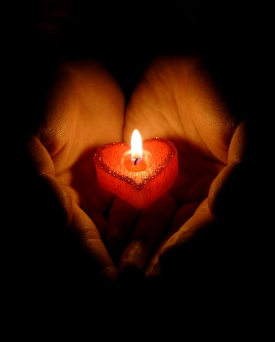 iStock_000007656438Small-Burning-Heart-Candle-w-Hands